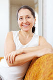 Portrait of beauty mature woman in home stock photography