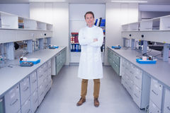 Portrait of a smiling biochemist standing with arms crossed Royalty Free Stock Images