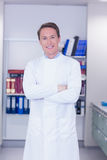 Portrait of a smiling biochemist standing with arms crossed Stock Photos