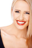 Portrait of smiling blond cute woman with red lipstick Royalty Free Stock Photography