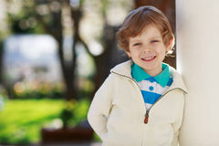 Portrait of smiling blond preschool boy, outdoors Stock Photography