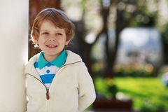 Portrait of smiling blond preschool boy, outdoors Royalty Free Stock Image