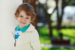 Portrait of smiling blond preschool boy, outdoors Royalty Free Stock Photography
