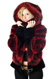 Portrait of smiling blond woman in fur jacket Stock Photo