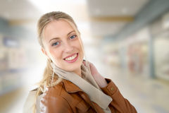 Portrait of smiling blond woman in shopping center Stock Photography