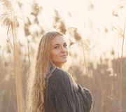 Portrait of a smiling blond woman smiling in a autumn day. Portrait of a smiling blond woman smiling outdoors in a autumn day Stock Photo