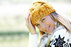 Portrait of smiling blond woman in winter clothes with norwegian pattern Royalty Free Stock Photo