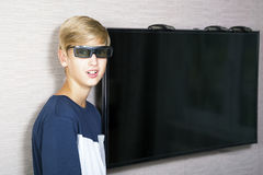 Portrait of smiling blonde boy. In 3 D glasses Stock Image
