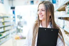 Portrait of smiling blonde female pharmacist Royalty Free Stock Photos