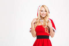 Portrait of smiling blonde female in red santa claus costume Stock Photography