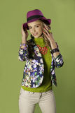 Portrait of smiling blonde girl wearing colorful outfit Royalty Free Stock Photography