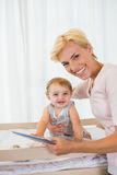 Portrait smiling of blonde with his son using digital tablet Stock Photos