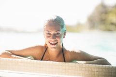 Portrait of smiling blonde in the pool Stock Image