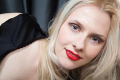 Portrait of a smiling blonde with red lips Stock Image