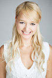 Portrait of a smiling blonde woman Stock Images
