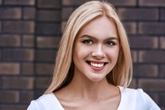 Portrait of smiling blonde woman stock images