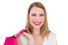 Portrait of a smiling blonde woman holding shopping bag Stock Image