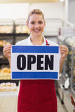 Portrait of a smiling blonde woman holding a sign Stock Photography