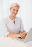 Portrait smiling blonde woman using laptop Royalty Free Stock Photography