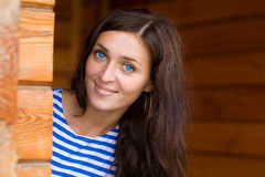 Portrait of a smiling blue-eyed brunette Royalty Free Stock Photography