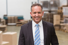 Portrait of a smiling boss standing Royalty Free Stock Images