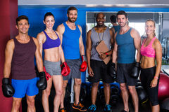 Portrait of smiling boxers with coach in gym Stock Images