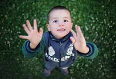 Portrait of Smiling Boy With Arms Outstretched Stock Photography