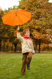 Portrait of smiling boy in autumn park Royalty Free Stock Photography