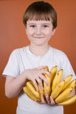 Portrait smiling boy with bananas Royalty Free Stock Photography