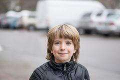 Portrait of a smiling boy with a blurred background royalty free stock images
