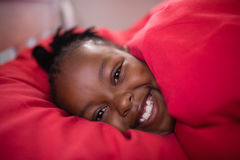 Portrait of smiling boy covering blanket at home Stock Image