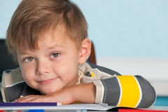 Portrait of a smiling boy at the desk Royalty Free Stock Images