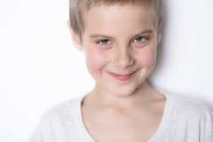 Portrait smiling boy of eight years. Stock Photography