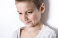 Portrait smiling boy of eight years. Royalty Free Stock Images