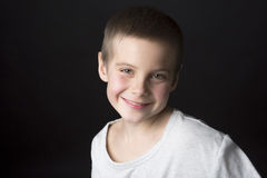 Portrait smiling boy of eight years. Royalty Free Stock Photography