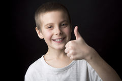 Portrait smiling boy of eight years. Royalty Free Stock Photo