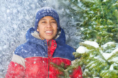 Portrait of smiling boy with falling snow flakes Royalty Free Stock Photos