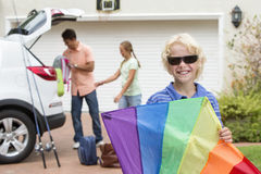 Portrait of smiling boy holding multicolor kite in driveway Royalty Free Stock Photography
