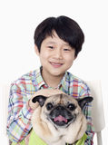 Portrait of Smiling Boy holding pet pug Stock Photos