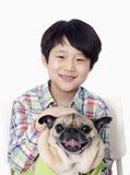 Portrait of Smiling Boy holding pet pug Stock Photos