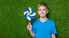 Portrait of smiling boy holding pinwheel Stock Photos