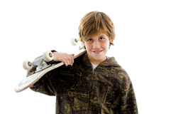 Portrait of smiling boy holding skateboard Royalty Free Stock Photography