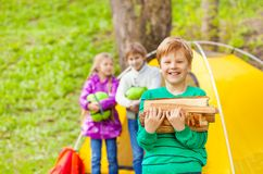 Portrait of smiling boy holding wood for bonfire Royalty Free Stock Photography