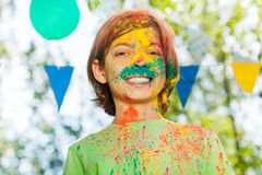 Portrait of smiling boy on Holi color festival Royalty Free Stock Photography
