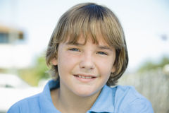 Portrait of Smiling Boy Outdoors Stock Images