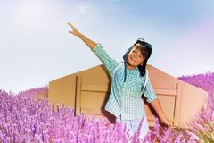 Smiling boy playing pilot in lavender field Stock Image