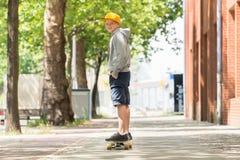 Boy Riding Skateboard royalty free stock images