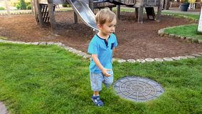 Portrait of smiling little boy running on grass lawn at park. Portrait of smiling boy running on grass lawn at park royalty free stock photos