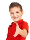Portrait of smiling boy showing handshake gesture Stock Images