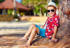 Portrait of smiling boy sitting under the tree Royalty Free Stock Photography